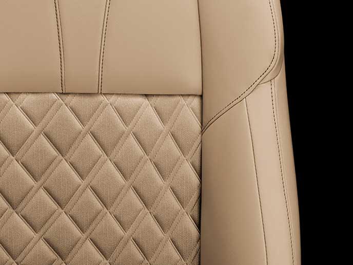 アイボリーの上級ファブリック+合成皮革の表皮